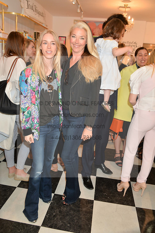 Left to right, LADY MARY CHARTERIS and TAMARA BECKWITH at a party to launch Biscuiteers Fashion Biscuit Collection inspired by Alice Naylor-Leyland's wardrobe held at Biscuiteers, 194 Kensington Park Road, London W11 on 23rd June 2015.
