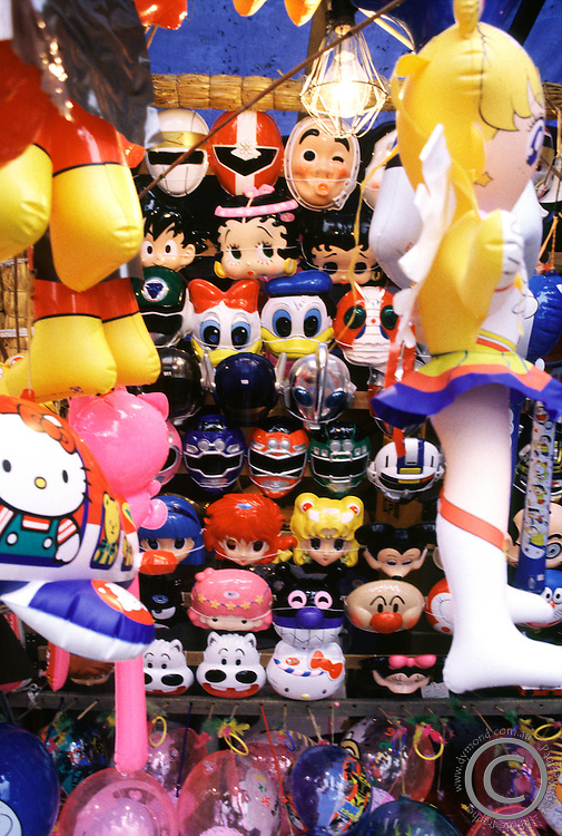 Various toy masks of cartoon and anime characters such as Anpanman and Donald Duck for sale at a festival in Sapporo, Hokkaido, Japan