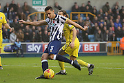 Millwall defender Joe Martin (3) with a shot during the EFL Sky Bet League 1 match between Millwall and Bristol Rovers at The Den, London, England on 12 November 2016. Photo by Matthew Redman.