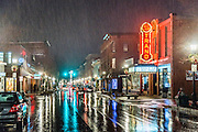 Traffic and pedestrians move down Main Street in Rockland on a rainy winter night. The Strand Theater and its beautiful red sign makes a great subject.