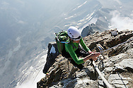 An alpinist on the Hornli ridge.<br /> <br /> &ldquo;Matterhorn 150 years Cervino&rdquo; - The year 2015 is the 150th Anniversary of the first ascent by Edward Whymper from the Swiss side (14th July) and by Jean Antoine Carrel from the Italian side on the 17th July 1865.<br /> <br /> On 17th July 2015 a friendship convention was signed by the members of Swiss, French, British and Italian climbing teams. A ceremony was held at the summit in honour of the mountain.