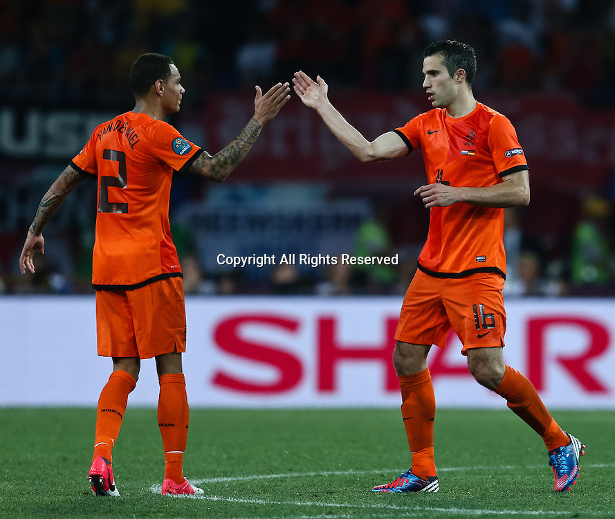 13.06.2012 Ukraine, Kharkiv.  Netherlands national team players Robin van Persie and Gregory van der Wiel in the group stage European Football Championship match between teams of the Netherlands and Germany.