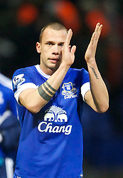 BOLTON, ENGLAND - Saturday, January 26, 2013: Everton's match-winner John Heitinga applauds the travelling supporters after his late goal sealed a 2-1 victory over Bolton Wanderers during the FA Cup 4th Round match at the Reebok Stadium. (Pic by David Rawcliffe/Propaganda)