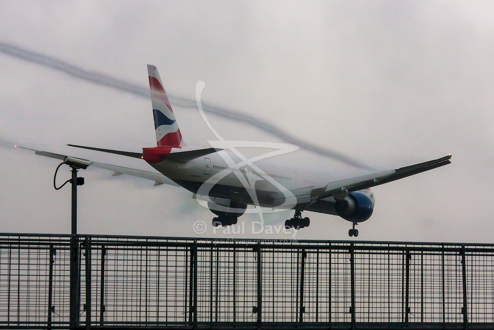 "January 3rd 2015, Heathrow Airport, London. Low cloud and rain provide ideal conditions to observe wake vortexes and ""fluffing"" as moisture condenses over the wings of landing aircraft. With the runway visible only at the last minute, several planes had to perform a ""go-round"", abandoning their first attempts to land. PICTURED: Wake vortices stream from the flaps of a British Airways Boeing 777 moments before it lands on Heathrow's runway 27L."