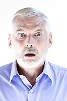 caucasian senior man portrait stun isolated studio on white background