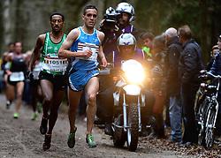 25-11-2012 ATLETIEK: NK CROSS WARANDELOOP: TILBURG<br /> Khalid Choukoud wint het NK maar wordt tweede op de warandeloop. Links  winnaar Dame Tasama BEL. <br /> ©2012-FotoHoogendoorn.nl