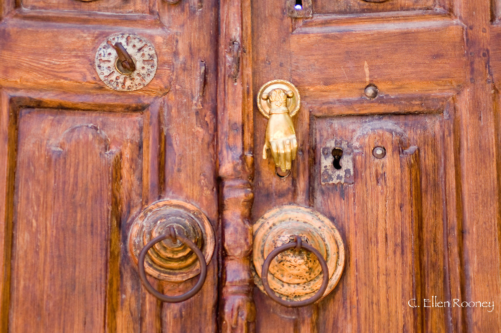 An old wooden door with distinctive hardware in Rhodes Town, Rhodes, Dodecanese Islands, Greece