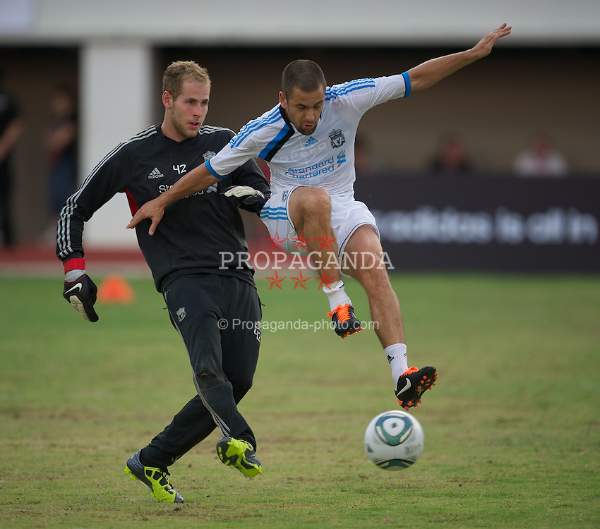 SINGAPORE, SINGAPORE - Sunday, July 17, 2011: Liverpool's goalkeeper Peter Gulacsi and Joe Cole during an exhibition training session at the Bishan Stadium in Singapore on day seven of the club's preseason Asia Tour. (Photo by David Rawcliffe/Propaganda)