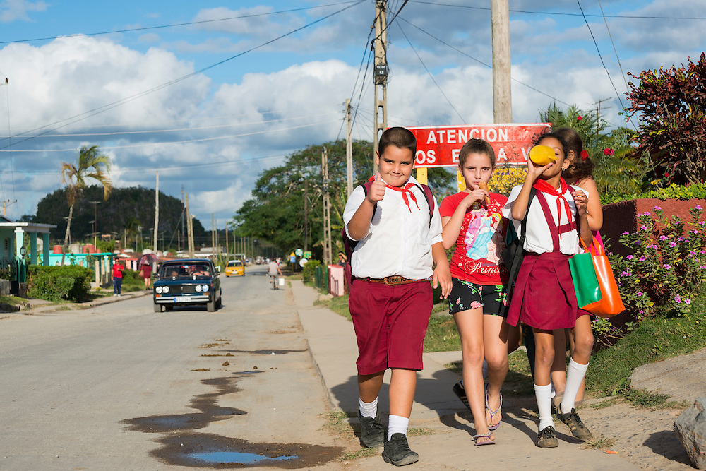 A boy and three girls walk home after school in Viñales, Pinar del Río Province, Cuba