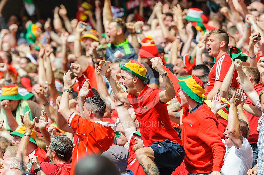 Wales fans celebrate gareth Bale's opening goal. Action from ENGLAND v WALES UEFA EURO 2016, 16 June 2016 in Stade Bollaert-Delelis. (c) Paul J Roberts / Sportpix.org.uk