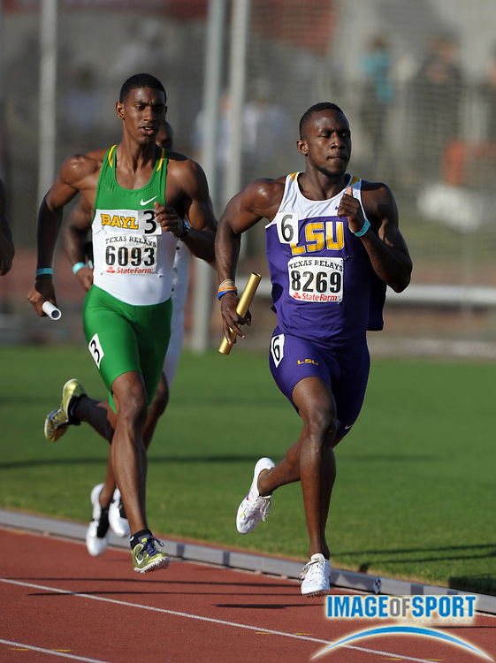 Mar 31, 2012; Austin, TX, USA; Ade Alleyne-Forte of LSU and James Gilreath  of Baylor run the third leg in the 4 x 400m relay in the 85th Clyde Littlefield Texas Relays at Mike A. Myers Stadium. LSU won in 3:04.54 and Baylor was second in 3:04.67.