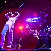 """January 8, 2012 - Manhattan, NY : Andrew W.K. (piano, vocals), left, gestures as he performs the song """"Dance Party"""" with the Calder Quartet at Le Poisson Rouge in Manhattan on Sunday evening.  CREDIT: Karsten Moran for The New York Times"""