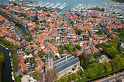 Nederland, Noord-Holland, Waterland, 28-04-2010; Monnickendam met Grote- of Sint Nicolaaskerk, jachthaven en Gouwzee in de achtergrond.luchtfoto (toeslag), aerial photo (additional fee required).foto/photo Siebe Swart