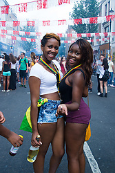 Party goers in the streets at the 2013 Notting Hill Carnival in West London, United Kingdom. Monday, 26th August 2013. Picture by Nils Jorgensen / i-Images