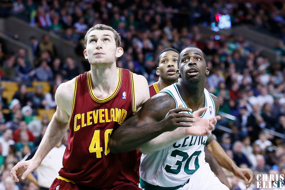 19 December 2012: Cleveland Cavaliers center Tyler Zeller (40) vies for the rebound with Boston Celtics power forward Brandon Bass (30) during the Boston Celtics 103-91 victory over the Cleveland Cavaliers at the TD Garden, Boston, Massachusetts, USA.