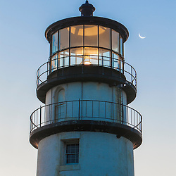 A crescent moon and the Cape Cod Lighthouse, a.k.a. Highland Light, in Truro, Massachusetts. Cape Cod National Seashore.