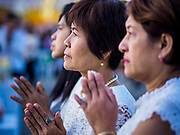 01 JANUARY 2019 - BANGKOK, THAILAND:   People pray during the New Year's merit making ceremony on the plaza in front of City Hall in Bangkok. City Hall traditionally hosts one of the largest New Year merit making ceremonies in Thailand. This year about 160 monks participated in the event.    PHOTO BY JACK KURTZ
