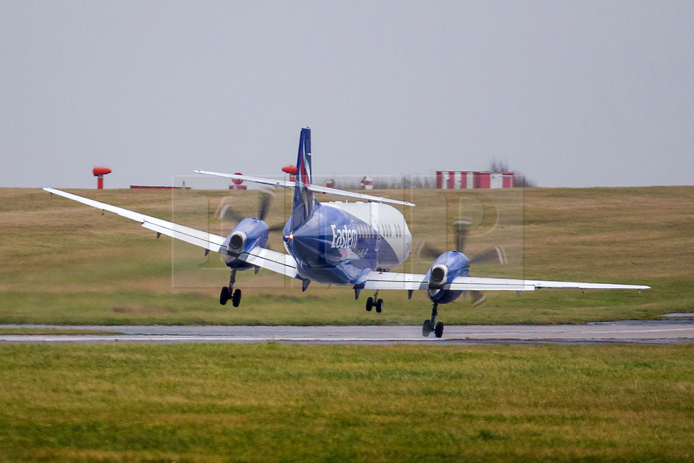 © Licensed to London News Pictures. 10/12/2019. Leeds UK. A Flybe aircraft arriving from Southampton struggles to land in strong cross winds at Leeds Bradford Airport this morning as Storm Brendan begins to batter the UK. Photo credit: Andrew McCaren/LNP