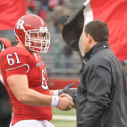 Dec 5, 2009; Piscataway, NJ, USA; Rutgers head coach Greg Schiano shakes hands with center Ryan Blaszczyk during the senior ceremony before first half NCAA Big East college football action between Rutgers and West Virginia at Rutgers Stadium.