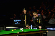 20.02.2016. Cardiff Arena, Cardiff, Wales. Bet Victor Welsh Open Snooker semi-finals. Mark Allen versus Neil Robertson. Mark Allen and Neil Robertson check the positioning of the cue ball.
