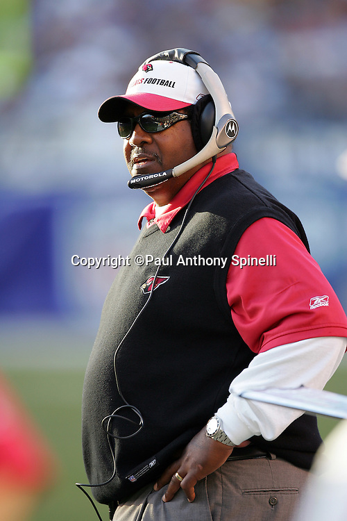 SAN DIEGO - DECEMBER 31:  Head Coach Dennis Green of the Arizona Cardinals works the sidelines with a headset during the game against the San Diego Chargers at Qualcomm Stadium on December 31, 2006 in San Diego, California. The Chargers defeated the Cardinals 27-20 to secure the number one seed in the AFC playoffs. ©Paul Anthony Spinelli *** Local Caption *** Dennis Green
