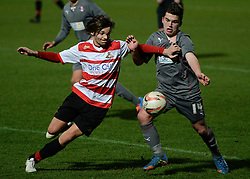© London News Pictures. 26/02/2014. Doncaster, UK. One Directions Louis Tomlinson (L) makes his debut for Doncaster reserves against Rotherham at the Keepmoat Stadium in Doncaster 26 February 2014 . Photo credit: London News Pictures.