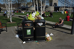 © LONDON NEWS PICTURES 2011. Photo by Paul Treacy. When the warm weather arrives London's bin overflow with rubbish as everyone wants to eat outside.