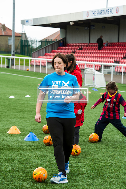 Pictured: Kezia Dugdale got stuck into the training session with her young teammates.<br /> <br /> Scottish Labour leader on campaign trail. Kezia Dugdale will visit Spartans Community Football Academy' 'Little Miss Kickers' programme - a programme designed to encourage the social and sporting development of girls aged 5-8, supported by Scottish FA qualified coaches.<br /> <br /> Ger Harley   EEm 15 April 2016