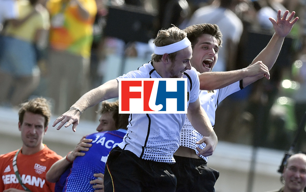 Germany's Moritz Trompertz (R) and Germany's Christopher Ruhr celebrate after winning the men's Bronze medal field hockey Netherlands vs Germany match of the Rio 2016 Olympics Games at the Olympic Hockey Centre in Rio de Janeiro on August 18, 2016. / AFP / PHILIPPE LOPEZ        (Photo credit should read PHILIPPE LOPEZ/AFP/Getty Images)