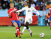 Nemanja Vidic (Serbia) and Kwadwo Asamoah (Ghana)compete for the ball during the 2010 FIFA World Cup South Africa Group D match between Serbia and Ghana at Loftus Versfeld Stadium on June 13, 2010 in Pretoria, South Africa.