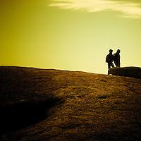 Silhouette of two people walking