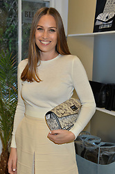 ANNA LAUB founder of Prism at the Prism Boutique Summer Party held at Prism, 54 Chiltern Street, London on 14th May 2014.
