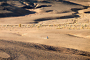 The wild Saharan dunes meet the Hamada near Touas village in Morocco, located just a few kilometres away from the Moroccan/Algerian border in the Erg Chebbi region of the Moroccan Sahara desert, near Merzouga, Southern Morocco, 2014-04-04. <br />