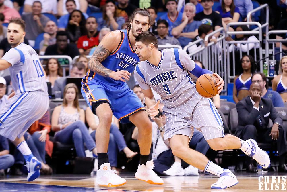 30 October 2015: Orlando Magic center Nikola Vucevic (9) drives past Oklahoma City Thunder center Steven Adams (12) during the Oklahoma City Thunder 139-136 double overtime victory over the Orlando Magic, at the Amway Center, in Orlando, Florida, USA.