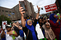 "Asma Jama, of Minneapolis, is energized during a march against the Trump administration's immigration policies on Saturday, June 30, 2018. ""America belongs to all of us,"" Jama said. ""I'm not gonna sit still."" Photo by Aaron Lavinsky/Minneapolis Star Tribune/TNS/ABACAPRESS.COM"