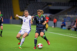 ASTANA, KAZAKHSTAN - Sunday, September 17, 2017: Wales' Gemma Evans and Kazakhstan's Svetlana Bortnikova during the FIFA Women's World Cup 2019 Qualifying Round Group 1 match between Kazakhstan and Wales at the Astana Arena. (Pic by David Rawcliffe/Propaganda)
