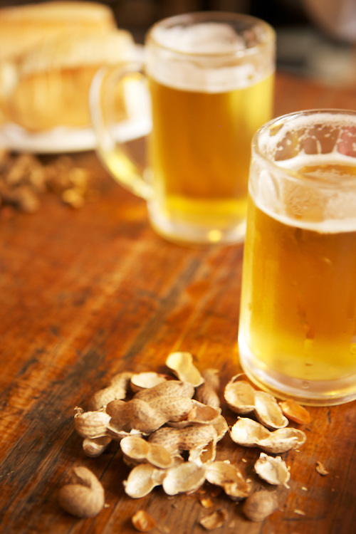 Argentina bar with beer and peanuts spread out on the tabletop