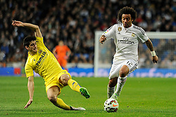 01.03.2015, Estadio Santiago Bernabeu, Madrid, ESP, Primera Division, Real Madrid vs FC Villarreal, 25. Runde, im Bild Real Madrid´s Marcelo Vieira and Villarreal CF´s Gerard Moreno // during the Spanish Primera Division 25th round match between Real Madrid CF and Villarreal at the Estadio Santiago Bernabeu in Madrid, Spain on 2015/03/01. EXPA Pictures © 2015, PhotoCredit: EXPA/ Alterphotos/ Luis Fernandez<br /> <br /> *****ATTENTION - OUT of ESP, SUI*****