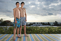 Two teenage boys (16-17) standing on wooden deck portrait