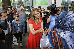 © Licensed to London News Pictures. 25/06/2017. London, UK. Camden Council leader GEORGIA GOULD speaks to concerned residents outside Swiss Cottage Leisure Centre, where residents of the Chalcots Estate tower blocks have been staying in Camden, London on Sunday, 25 June 2017. The Camden Council ordered the evacuation of the towers but there are many residents refusing to leave even though the cladding of the buildings failed the fire safety test. Photo credit: Tolga Akmen/LNP