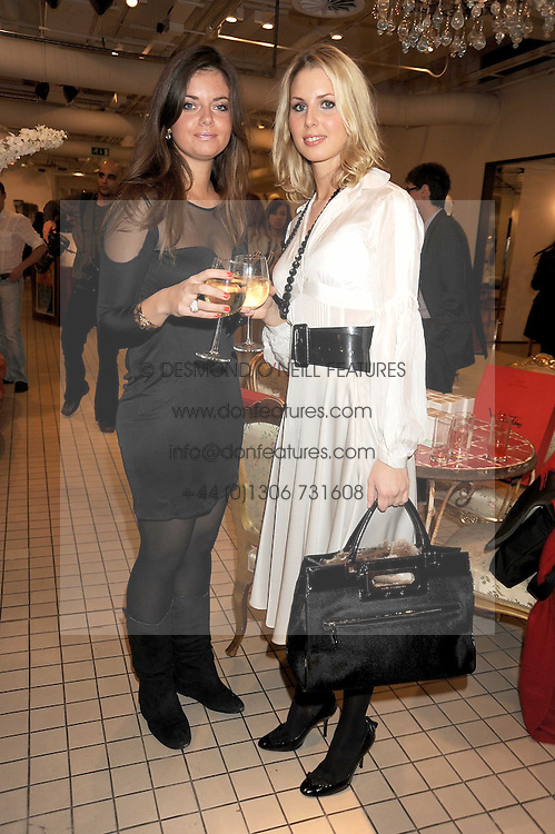 Left to right, LADY NATASHA RUFUS-ISAACS and ISABELLE COATEN at a party to celebrate the 2nd issue of Distill Magazine held at The Shop at Bluebrid, Kings Road, London on 1st December 2008.