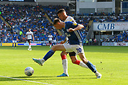 Gavin Whyte (20) of Cardiff City battles for possession with Marvin Johnson (21) of Middlesbrough during the EFL Sky Bet Championship match between Cardiff City and Middlesbrough at the Cardiff City Stadium, Cardiff, Wales on 21 September 2019.