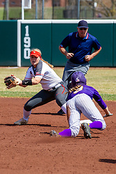 NORMAL, IL - April 06: Umpire Bryan Smith observes a play at 2nd where Emme Olson gets the ball ahead of runner Courtney Krodinger during a college women's softball game between the ISU Redbirds and the University of Northern Iowa Panthers on April 06 2019 at Marian Kneer Field in Normal, IL. (Photo by Alan Look)