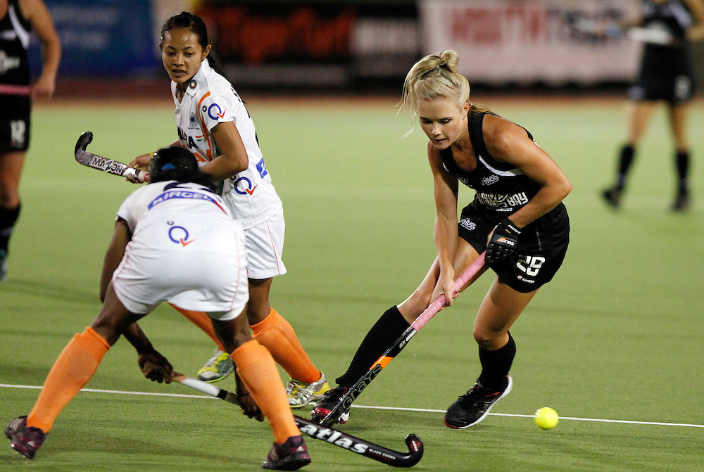 New Zealand's Charlotte Harrison takes on the India defence during their 4 nations hockey match at North Harbour Hockey Stadium, Auckland, New Zealand, Thursday, April 12, 2012. Credit:SNPA / Ben Campbell..