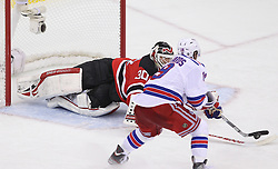 May 19, 2012; Newark, NJ, USA; New Jersey Devils goalie Martin Brodeur (30) makes a poke check save on New York Rangers center Brad Richards (19) during the second period in game three of the 2012 Eastern Conference Finals at the Prudential Center.