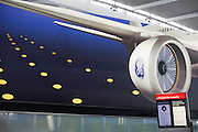 A General Electric advertisement for its airliner engines near security departure gate at Heathrow Airport's Terminal 5.