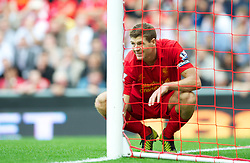LIVERPOOL, ENGLAND - Sunday September 2, 2012: Liverpool's captain Steven Gerrard looks dejected as his side lose 2-0 to Arsenal during the Premiership match at Anfield. (Pic by David Rawcliffe/Propaganda)