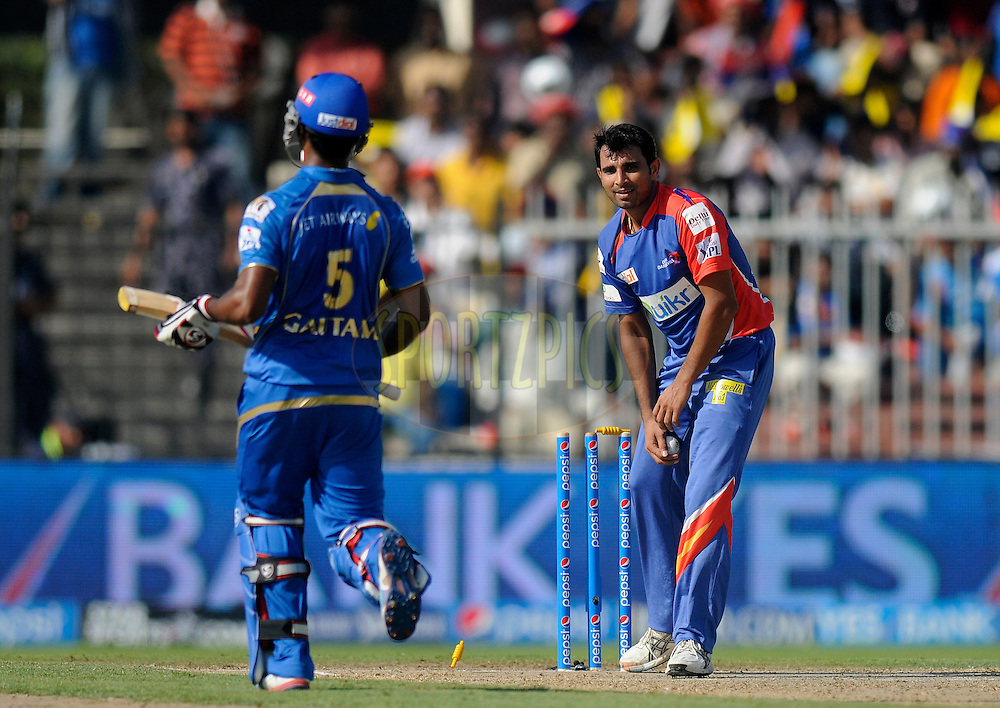 Mohammad Shami of the Delhi Daredevils takes the bails off to get the wicket of CM Gautam of the Mumbai Indians during match 16 of the Pepsi Indian Premier League 2014 between the Delhi Daredevils and the Mumbai Indians held at the Sharjah Cricket Stadium, Sharjah, United Arab Emirates on the 27th April 2014<br /> <br /> Photo by Pal Pillai / IPL / SPORTZPICS