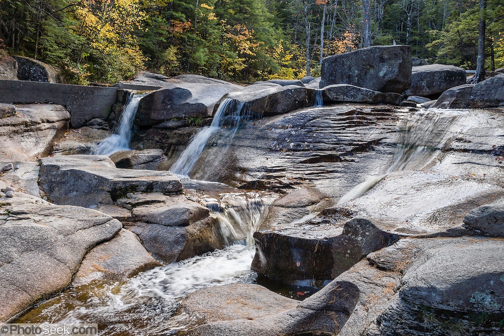 Diana's Baths are a collection of beautiful pools and waterfalls descending 75 feet (23 m) vertically along Lucy Brook on North Moat Mountain, in White Mountain National Forest, New Hampshire, USA. The easy 1.2-mile roundtrip walk starts at the Diana's Baths parking lot on West Side Road in Bartlett, near North Conway. An 1800s sawmill operation here was abandoned by the Lucy family in the 1940s then converted into a historic site protected by the US Forest Service. The White Mountains (a range in the northern Appalachian Mountains) cover a quarter of the state of New Hampshire. Leaf peepers enjoy the peak of autumn foliage around the first week of October.