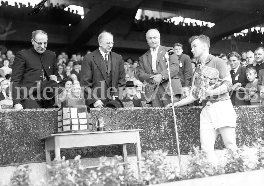 Tony Wall with the McCarthy cup after they defeated  Wexford in the 1962 All-Ireland hurling Final. Wall accepted the trophyon behalf of the injured captain. (Part of Independent Newspapers Ireland/NLI Collection)